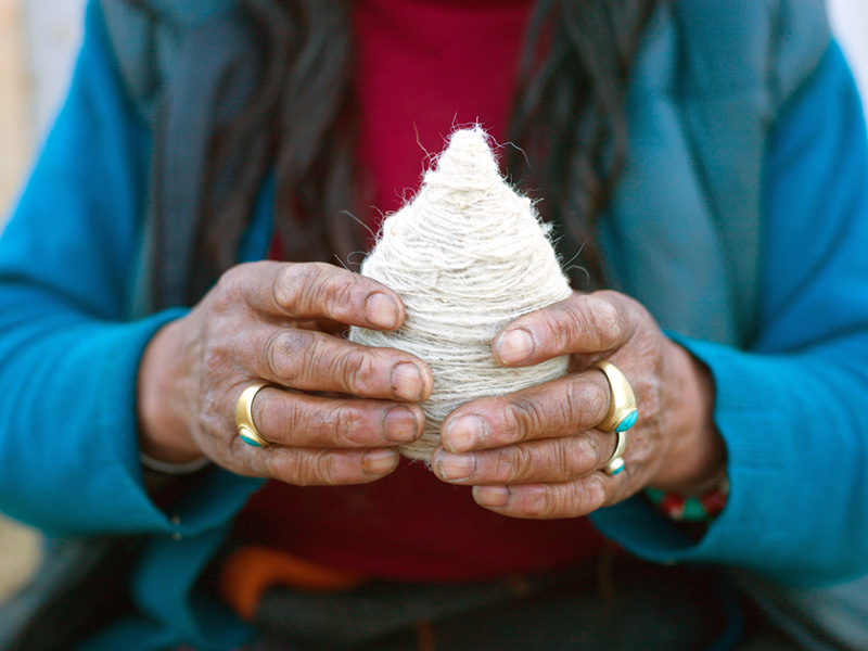 Bhutan - Rural life - A Layap woman from Laya holding a ball of sheep wool which was spun using a drop spindle called a Yoekpa