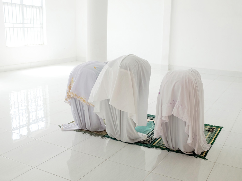 Vietnam - Midday prayers in the women's room at a mosque in the Muslim Cham village of Van Lam