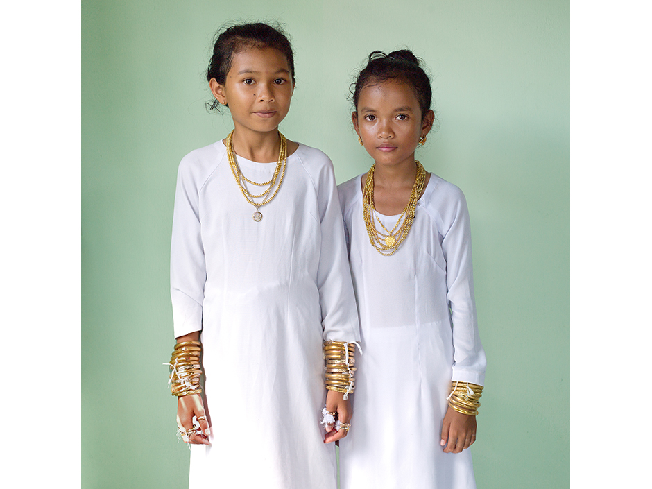 Vietnam - Muslim Cham ethnic minority - A portrait of two girls at their Karoh (maturity) ceremony